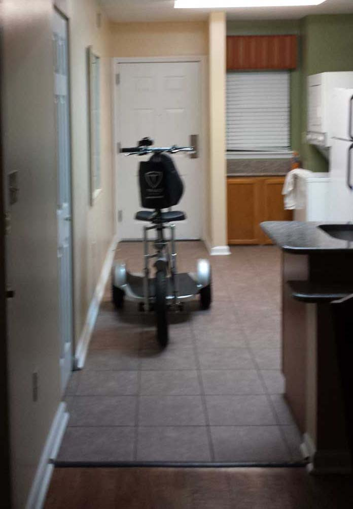 A scooter fits in the kitchen